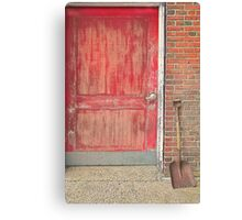 Red doorand shovel Canvas Print