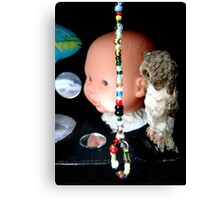 Black Box With Noose of Beads and Big Baby  Canvas Print