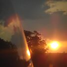 Texas sunset from the rearview by Jamie  Armbruster