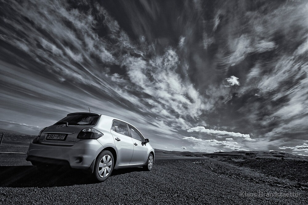 Iceland Sky with a car by Klaus Brandstaetter