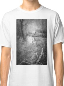 in this dark forest, lights can be seen Classic T-Shirt