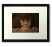 The Doll Framed Print