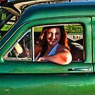 Redhead in green car by Bryan D. Spellman