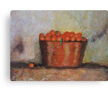 Oranges in basket Canvas Print