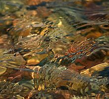 wavy water over rocks by wolf6249107