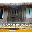 Hoi An roof and upper windows and doors.. by John Mitchell