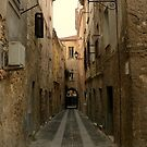 A narrow street  by Michele Filoscia