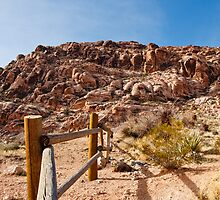 Wood Rail Fence Into Desert Toward Mountains by dbvirago