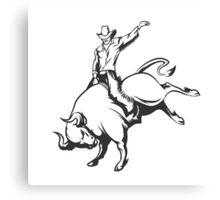 Rodeo cowboy riding a wild bull Canvas Print