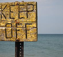 Keep Off- warning on the rocks of Lake Michigan by Piper Patterson