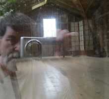 A reflective self portrait reflecting on the under construction studio by abigcat