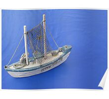 Toy Boat on Blue Table Poster