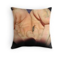 One in the Hand. Throw Pillow