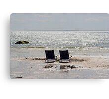 Two beach chairs on a sand bar Canvas Print