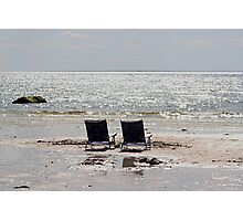 Two beach chairs on a sand bar Photographic Print