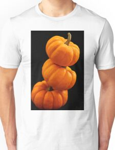 Pumpkins on black background Unisex T-Shirt