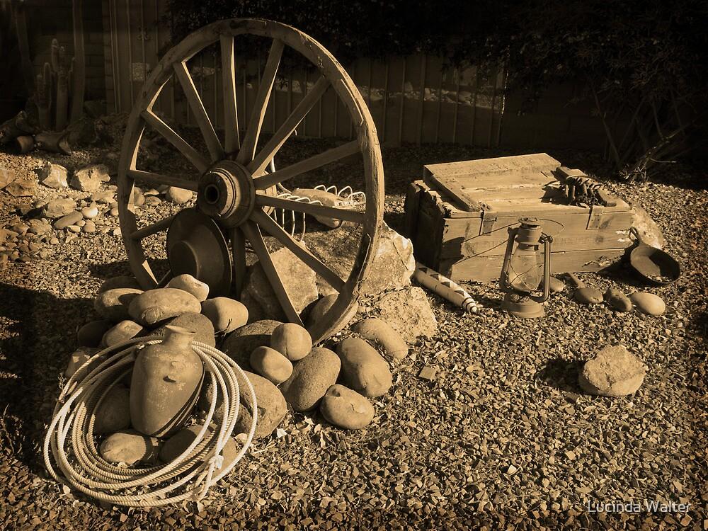 Wagon Wheel, Rope and Lantern by Lucinda Walter
