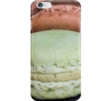 Colorful macarons on a black wood iPhone Case/Skin