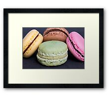 Colorful macarons on a black wood Framed Print