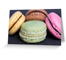 Colorful macarons on a black wood Greeting Card