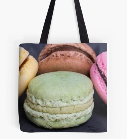 Colorful macarons on a black wood Tote Bag