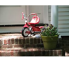 Tricycle on porch Photographic Print