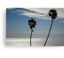 Palm trees on the ocean Canvas Print