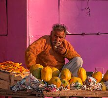 Colourful Fruit Vendor by Clive S