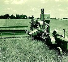 My grandfather working his combine in the early 1930s by Samohsong