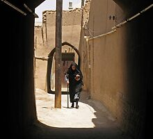 Veiled woman in the streets of Yazd, Iran by Yulia Manko