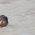 A young kid in Ganga by Dayal
