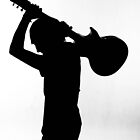 Silhouette of a musican  by Nina  Matthews Photography