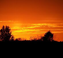 Orange Sunset over Warsaw, Indiana by Bonnie Phillips