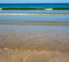 gentle soft waves lashing onto ballybunion sand by morrbyte
