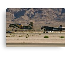 Pair of A-1 Skyraiders take off. Canvas Print