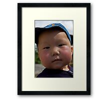 Curious, cute Kyrgyz kid... Framed Print