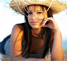 beauty young woman on the beach by plamenx