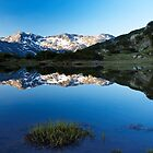 sunrise reflection of mountain peak to the lake by plamenx
