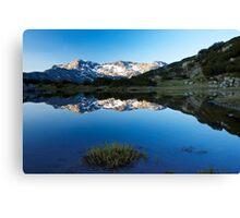 sunrise reflection of mountain peak to the lake Canvas Print