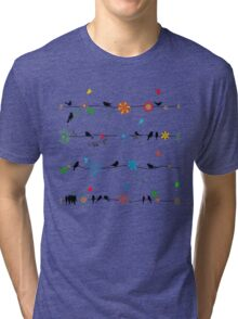 Birds on a wire with brightly colored flowers. Tri-blend T-Shirt