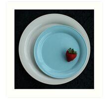 strawberry on a blue plate Art Print