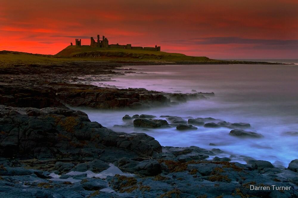 Dunstanburgh Castle at sunset by Darren Turner