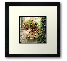 La bicyclette aux Géraniums Framed Print