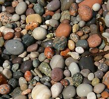 Pebbles on the beach by John Butterfield