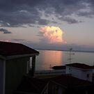 Sun reflection caught  on cloud - Skala Kafelonia Greece by mikequigley