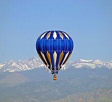 Ballooning with Indian Peaks in background by Klaus Girk