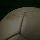 soccer ball in the field by JRicca