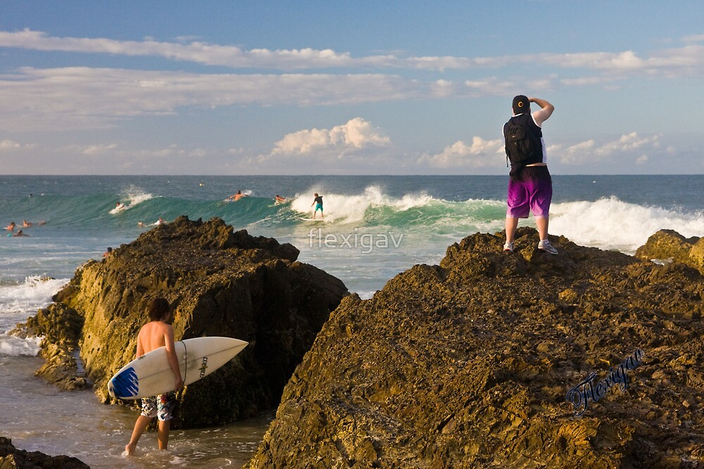 Surfing photographer at work by flexigav