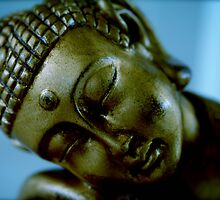 golden buddha face by simplyzenimages