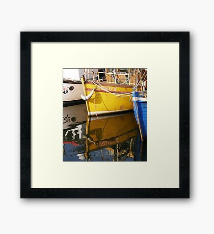 Yellow Boat Reflection Framed Print